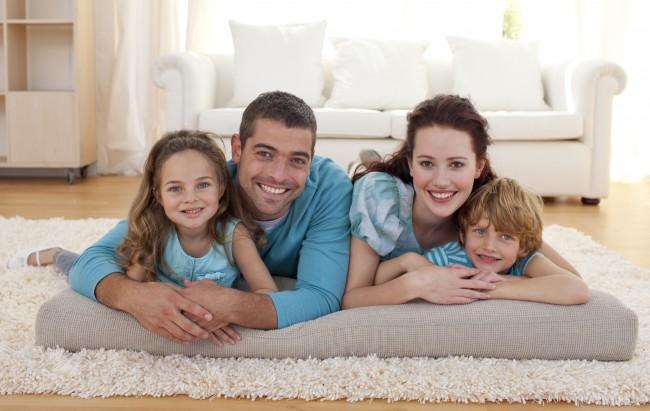 bigstock_Family_On_Floor_In_Living-room_6143968