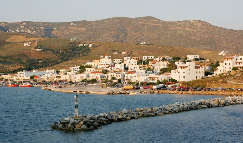 port-in-andros-and-white-traditional-houses-at-sunset
