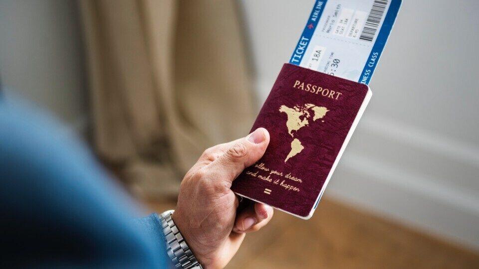 adult-blur-business-trip-passport-red